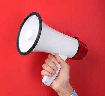 shutterstock_1015032061-megaphone-announcement-tile